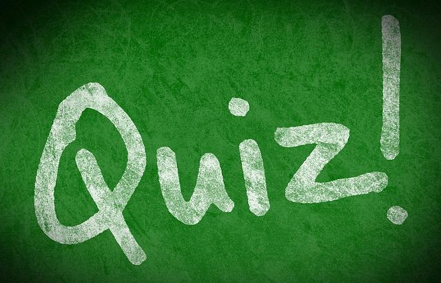 Quiz! written in chalk on a green board.