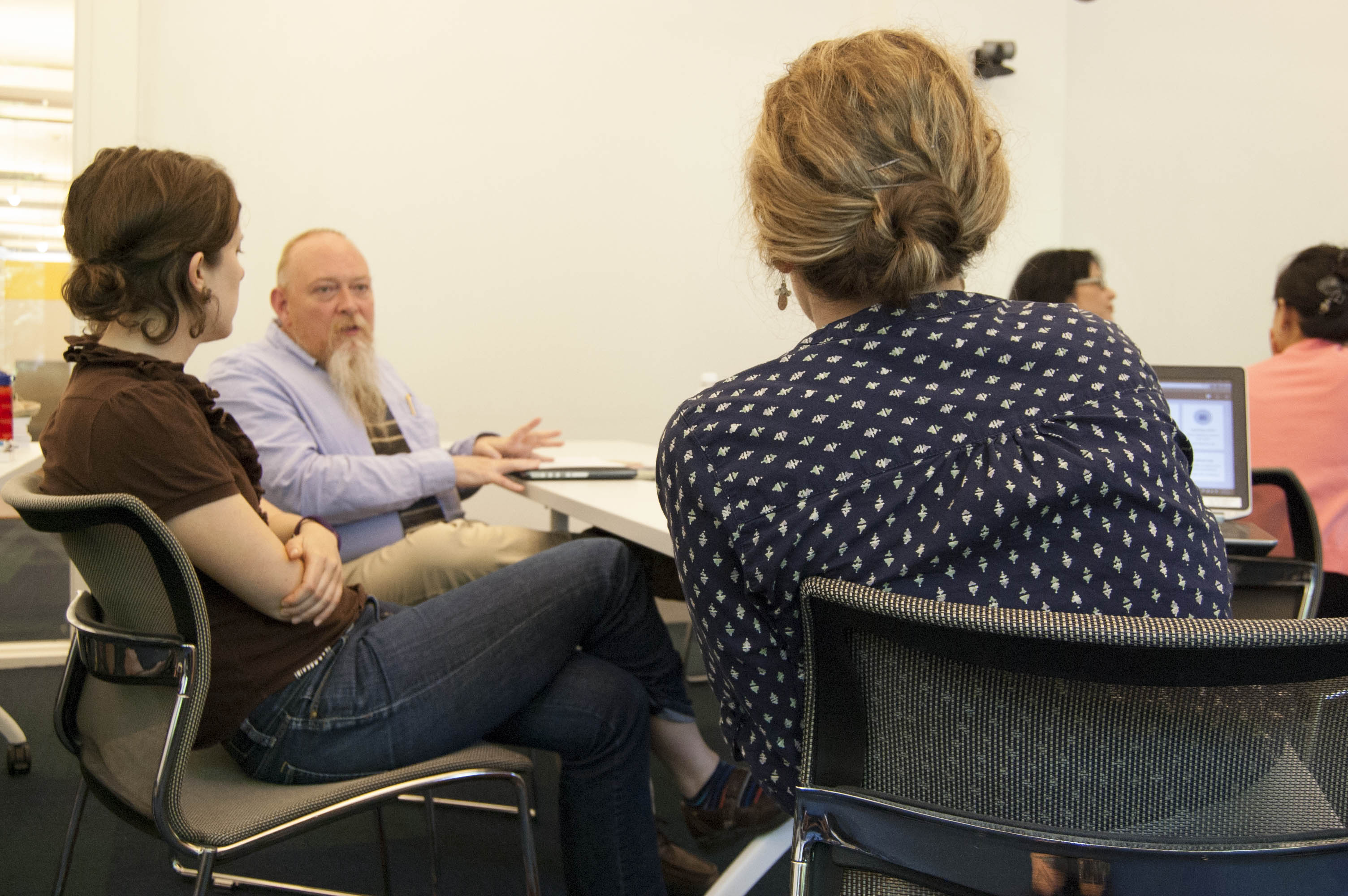 Randy Riddle consults with faculty