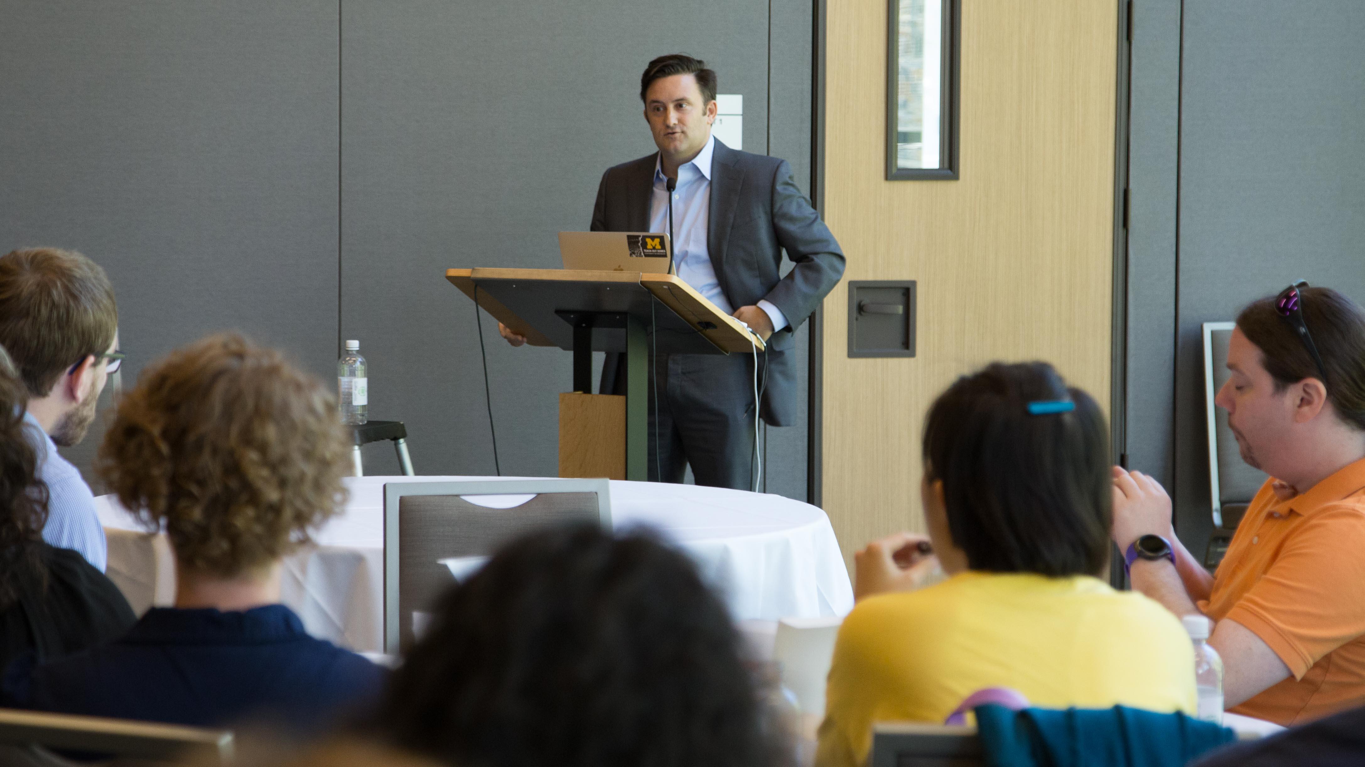 James DeVaney speaking at Duke