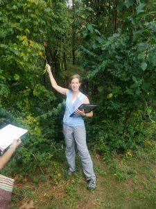 Nicolette Cagle showing features of a tree to students.